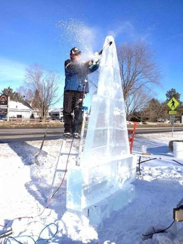 An ice carver works on a sculpture to be displayed at the Stowe Winter Carnival.